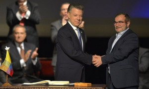 Juan Manuel Santos and Timochenko shake hands during the signing of the new peace agreement. Photograph: Luis Robayo/AFP/Getty Images'